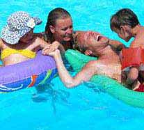 Family in Clean Swimming Pool